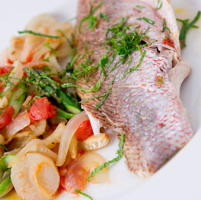 Whole roast red snapper with farmers market vegetable melange.